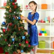 Little girl decorating christmas tree — Stock Photo #15844955