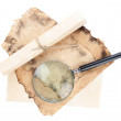 Old paper with magnifying glass isolated on white — Stock Photo #15845401