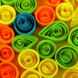Zdjęcie stockowe: Colorful quilling on yellow background close-up