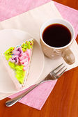 Creamy cake on saucer on table close-up — Stock Photo