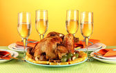 Banquet table with roasted chicken on orange background close-up. Thanksgiving Day — Foto Stock