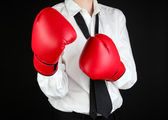 Businessman in boxing gloves isolated on black — Foto Stock