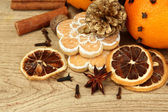 Composition of christmas spices and tangarines, on wooden background — Стоковое фото