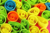 Colorful quilling on pink background close-up — 图库照片