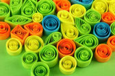 Colorful quilling on green background close-up — Stok fotoğraf