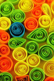 Colorful quilling on yellow background close-up — Foto Stock