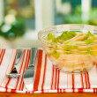 Salad of squid rings, lemon and lettuce in a glass bowl on wooden table close-up — Stock Photo #15971917