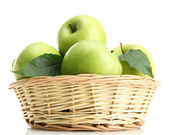 Ripe green apples with leaves in basket isolated on white — Stock Photo
