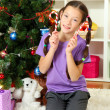 Little girl decorating christmas tree — Stock Photo #15987495