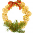 Christmas wreath of dried lemons with fir tree and bow isolated on white — ストック写真