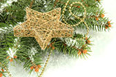Christmas star on fir tree with snow, isolated on white — Stock Photo
