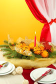 Beautiful christmas table setting with tangerines and fir tree, close up — Stock Photo