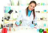 Young scientist with Petri dish in laboratory — Stock Photo