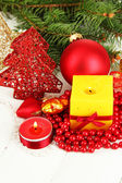 Yellow candle with christmas decoration on light background — Stock Photo
