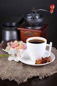White cup of Turkish coffee with rahat delight, coffee pot and coffee mill on wooden table — Stock Photo