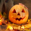 Royalty-Free Stock Photo: Halloween pumpkin and autumn leaves, on wooden background