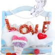 Beautiful decorative composition on Love isolated on white - Stock Photo