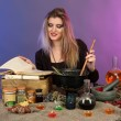 Halloween witch stirring in poison soup in her cauldron on color background — Stockfoto
