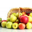 Juicy apples with green leaves in basket, isolated on white — Stock Photo