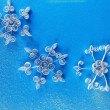 Beautiful paper snowflakes, on blue background — Stock Photo
