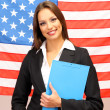 Stock Photo: Young womwith Americflag