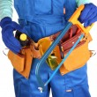 Male builder in blue overalls with saw isolated on white - Stock Photo