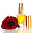 Women's perfume in beautiful bottle with rose isolated on white - Stock Photo