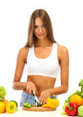Beautiful young woman cutting vegetables, isolated on white — Stock Photo