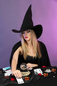 Witch - fortuneteller on color background — Stock Photo