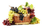 Assortment of ripe sweet grapes in basket, isolated on white — Stock Photo