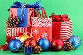 New Year composition of New Year's decor and gifts on green background — Stock Photo