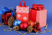 New Year composition of New Year's decor and gifts on blue background — Foto Stock