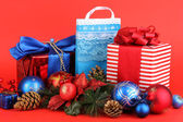 New Year composition of New Year's decor and gifts on red background — Stock Photo