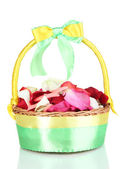 Wedding basket with rose petals isolated on white — Stock Photo