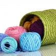 Colorful yarn for knitting in green basket isolated on white — Stock Photo #16235057