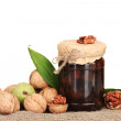 Royalty-Free Stock Photo: Jam-jar of walnuts on sacking