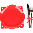 Empty red plate with fork and knife on colorful napkin, isolated on white — Stock Photo #16235339