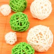 Wicker bamboo balls on bamboo mat — Stock Photo #16235381