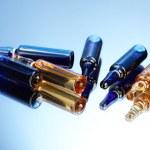 Medical ampules on blue background — Stock Photo #16235405