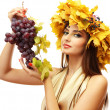 Beautiful young woman with yellow autumn wreath and grapes, isolated on white — Stock Photo #16236777