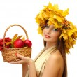 Beautiful woman with wreath and basket with apples and berries, isolated on white — Stock Photo #16236781