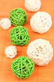 Wicker bamboo balls on bamboo mat — Stock Photo
