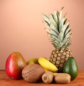 Still life of fruit on a table on a brown background — Stock Photo