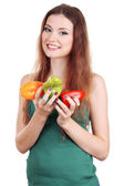 Beautiful woman with pepper isolated on white — Stockfoto
