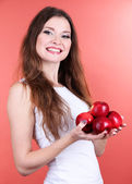 Beautiful woman with apples on pink background — Stock Photo