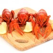 Stock Photo: Tasty boiled crayfishes on chopping board isolated on white