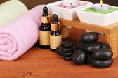 Spa setting on wooden table on brown background — Stock Photo