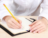 Closeup of businesswoman hands, writing on paper — Stock Photo