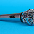 Silver microphone on blue background — Stock fotografie