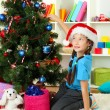 Little girl decorating christmas tree — Stok Fotoğraf #16270673